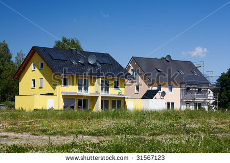 Stock-photo-two-houses-with-solar-panels-and-satellite-dishes-under-construction-31567123_medium