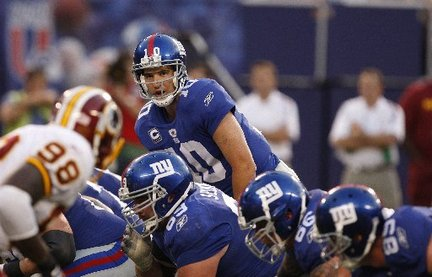Eli-manning-giants-offensive-line-9574950bbdeb0df0_large_medium