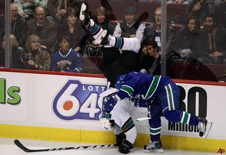Douglas-murray-dan-hamhuis-2010-11-27-0-31-14_medium