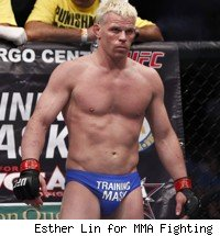 Dennis Hallman wears tight blue shorts for his UFC 133 fight.