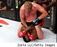 Josh Barnett punches Brett Rogers during their fight at Overeem vs. Werdum.
