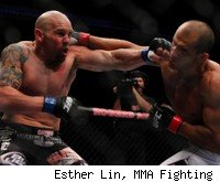 Junior Dos Santos slugs with Shane Carwin at UFC 131.