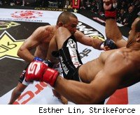Dan Henderson punches Rafael Feijao at Strikeforce in Columbus.