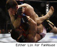 Forrest Griffin tries to punch Rich Franklin at UFC 126