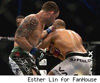 Frankie Edgar beats B.J. Penn at UFC 112 in Abu Dhabi.