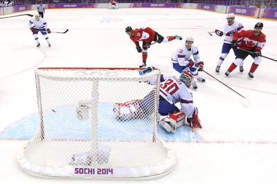 2014 Winter Olympics: Big Wins for Finland, Canada and Russia as Tournament Favorites Roll